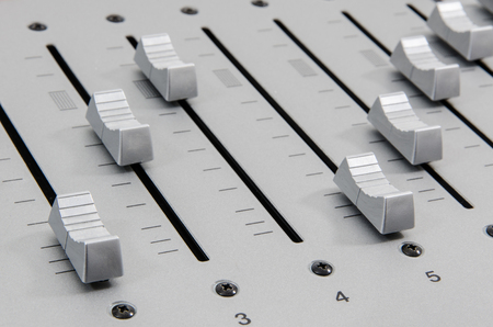 decibel: closeup of slider buttons forming diagonal lines