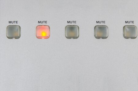 turned out: five mute buttons with one standing out as lit and other turned off