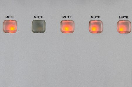 turned: five mute buttons with one standing out as turned off and all other lit