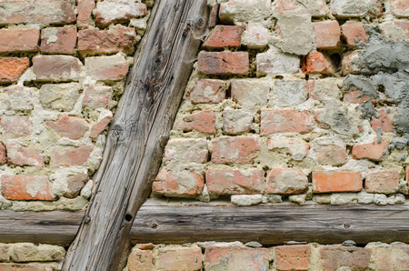 framing: background of an old weathered brick wall with timber framing