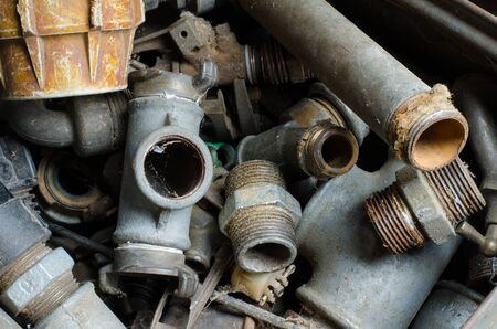 dusty: closeup of old dusty metal pipe couplings, fittings and adaptors