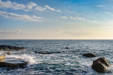 beautiful view of the horizon between he sky and the sea from the rocky shore of Genoa Nervi in Italy