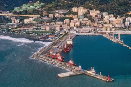 sea port: birds eye view of the harbor and the neighborhood Pegli at the airport of Genoa in Italy