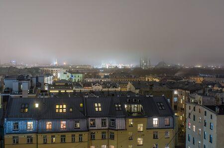 上から霧の夜のリガ中心部 写真素材
