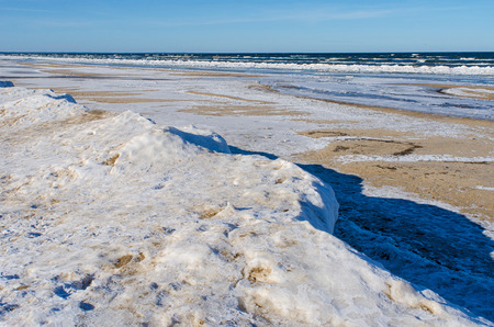 ice at the beach of Jurmala, a resort town at the Gulf of Riga, looking out into the cold Baltic sea