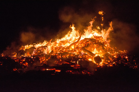 details of a huge bonfire burning in the night