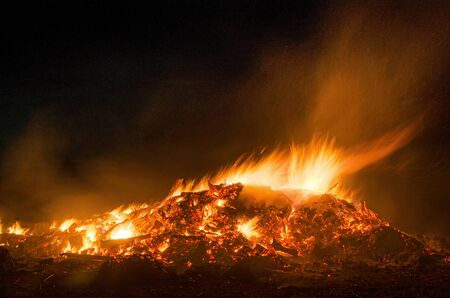 beautiful flames atop a huge traditional Easter bonfire reaching into the dark of the rural sky