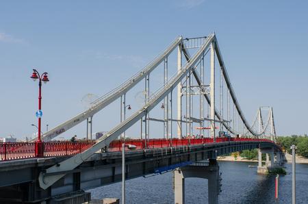 Pedestrian Park Bridge to the Truhaniv Island in Kiev, Ukraine, on a sunny summer day 写真素材