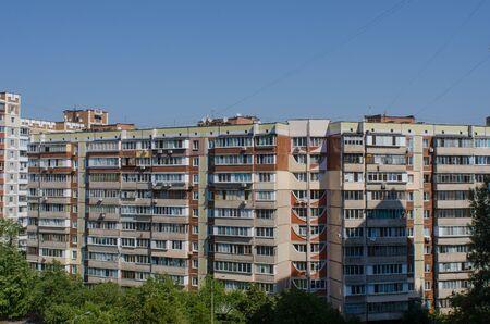 soviet era residential buildings in the green capital of Ukraine, Kiev, on a sunny summer day