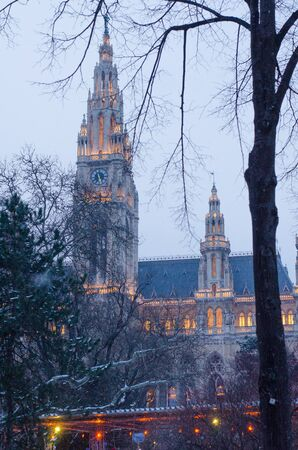 the illuminated historic municipal building of Vienna on a winter evening