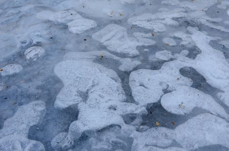 frozen water surface with interesting patterns