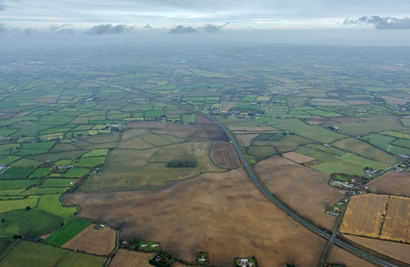 typical irish agricultural landscape from above on a cloudy day