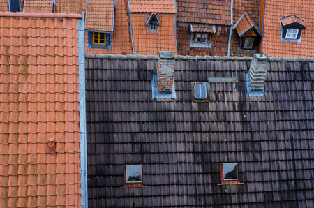 A collage of narrow rooftops of half-timbered houses in the old town of Quedlinburg in Germany