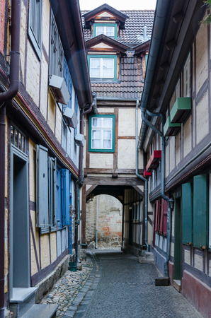 narrow alley in between medieval half-timbered houses in the old town of Quedlinburg in Germany 写真素材