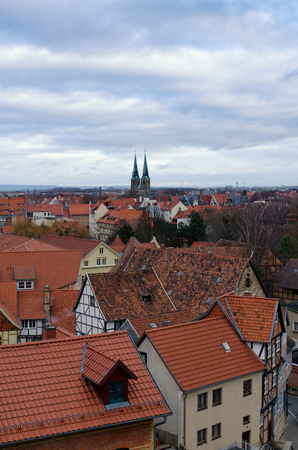 View of the old town of Quedlinburg from above with the Saint Nicholas church on the horizon 写真素材