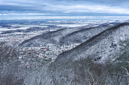 The town of Thale in central Germany embedded in the Harz mountain range on a beautiful winter day under an amazing cloudy sky