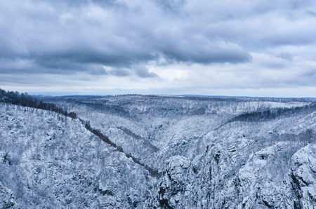 Vast Harz mountain range of central Germany under a moody clouds sky in winter 写真素材