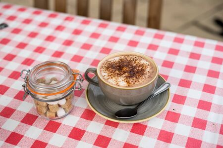Hot Chocolate on Garden Table of English pub in Midlands, UK Stock Photo