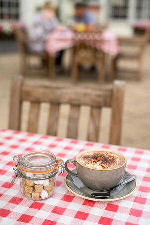 Hot Chocolate on Garden Table of English pub in Midlands, UK