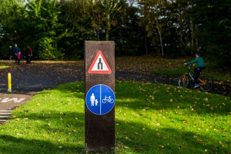 Bike and walking sign in park. Shared path for pedestrians and cyclists