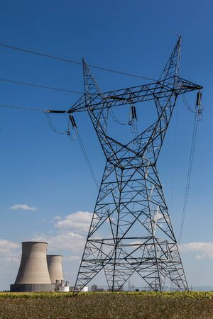 Energy Station on farm. Electric Power Lines and Transmission
