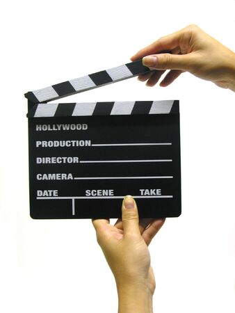 A photo of a woman holding a clapboard Stock fotó