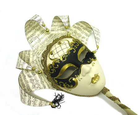 A photo of an artistic mask with a music theme