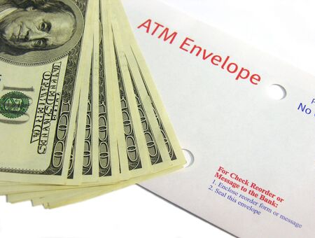 A photo of an ATM deposit envelope with cash
