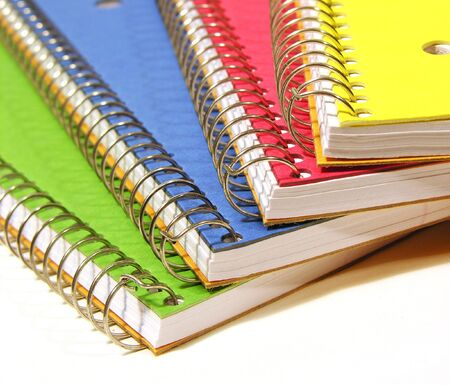A photo of four colorful notebooks