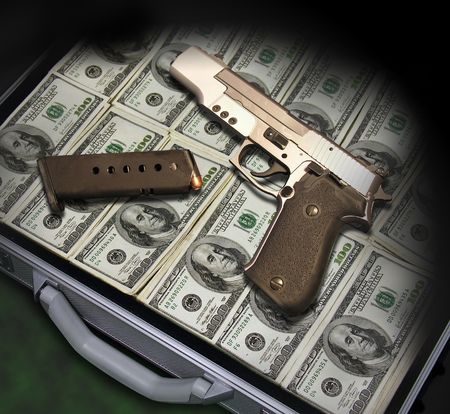 stash: A photo of a gun sitting on a pile of money in a suitcase