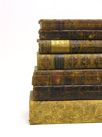 A photo of old books stacked on top of each other