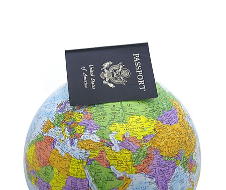A photo of a passport on a globe
