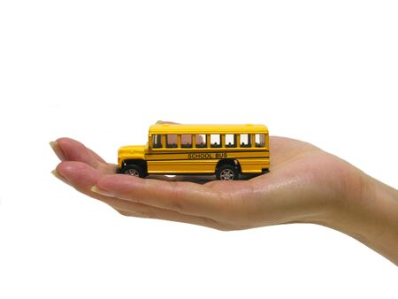 A photo of a woman holding a school bus Imagens