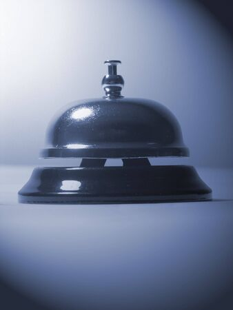 A photo of a bell used to solitcit service