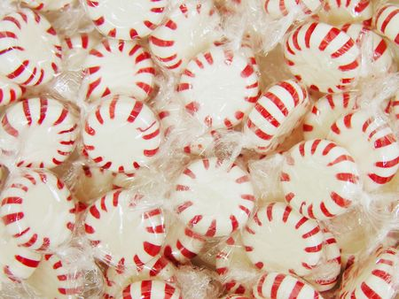 A photo of a bowl of peppermint candy