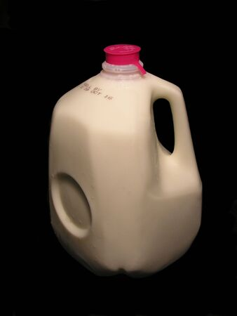 Milk on a dark background photo