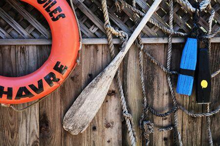 oar: Life preserver, oar, and netting