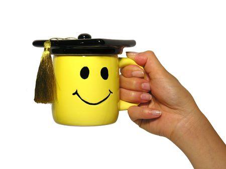 doctorate: Woman holding graduation mug