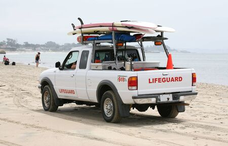 resuscitate: Lifeguard in truck with surfboards