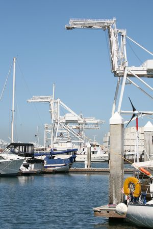 Cranes and boats in the port Stock Photo