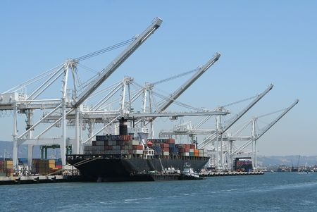 Cargo ship at port being loaded by cranes