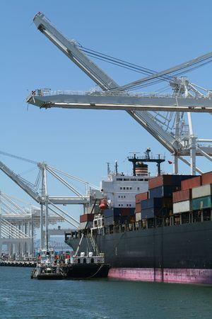 Cranes and cargo ship at port Stok Fotoğraf