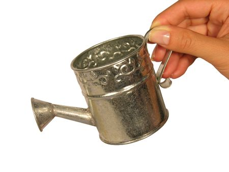 Woman holding a miniature watering can photo