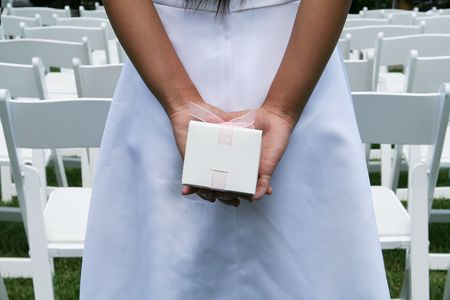 Girl with gift at wedding