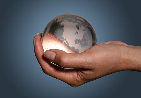 Woman holding glass globe photo