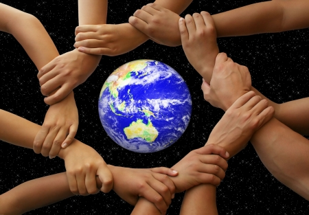 friendship circle: Hands framing the earth in a global team theme