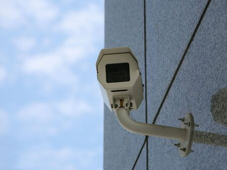 electronic survey: Security camera attached to building