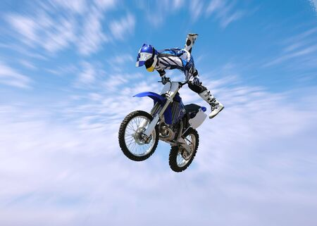 dirt: A stunt rider doing tricks on his dirt bike Stock Photo