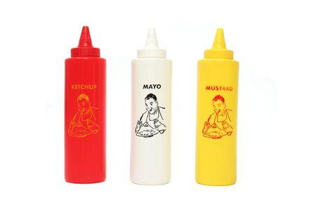 Isolated Ketchup, Mayo and Mustard bottles photo