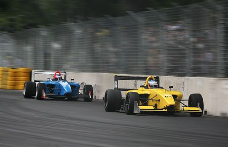 Race cars racing at the grand prix Stock Photo